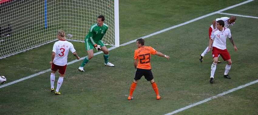 Denmark's goalkeeper Thomas Soerensen (2ndL) fails to catch a shot by Denmark's defender Simon Poulsen (back, R) after he scored an own goal during the Group E first round 2010 World Cup football match Netherlands vs. Denmark on June 14, 2010 at Soccer City stadium in Soweto, suburban Johannesburg.