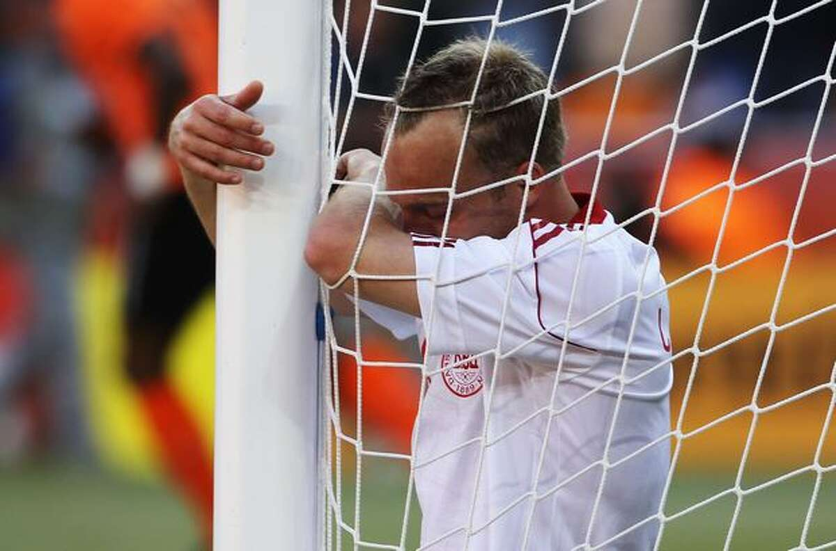 Lars Jacobsen of Denmark looks dejected as Dirk Kuyt of the Netherlands scores from the rebound after the ball hits the post during the 2010 FIFA World Cup Group E match between Netherlands and Denmark at Soccer City Stadium on June 14, 2010 in Johannesburg, South Africa.