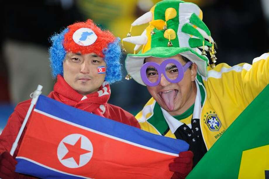Football fans supporting Brazil and North Koera enjoy the atmosphere ahead of the 2010 FIFA World Cup South Africa Group G match between Brazil and North Korea at Ellis Park Stadium. Photo: Getty Images / Getty Images