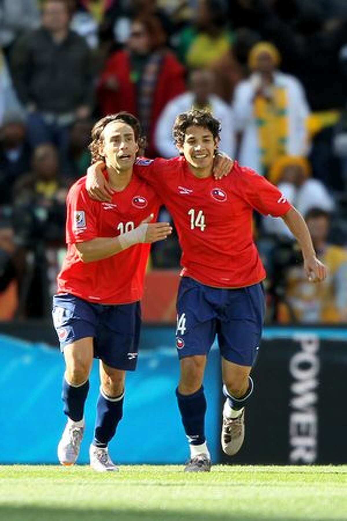 Jorge Valdivia of Chile (L) celebrates the opening goal with team mate Matias Fernandez during the 2010 FIFA World Cup South Africa Group H match between Honduras and Chile at the Mbombela Stadium on June 16, 2010 in Nelspruit, South Africa.