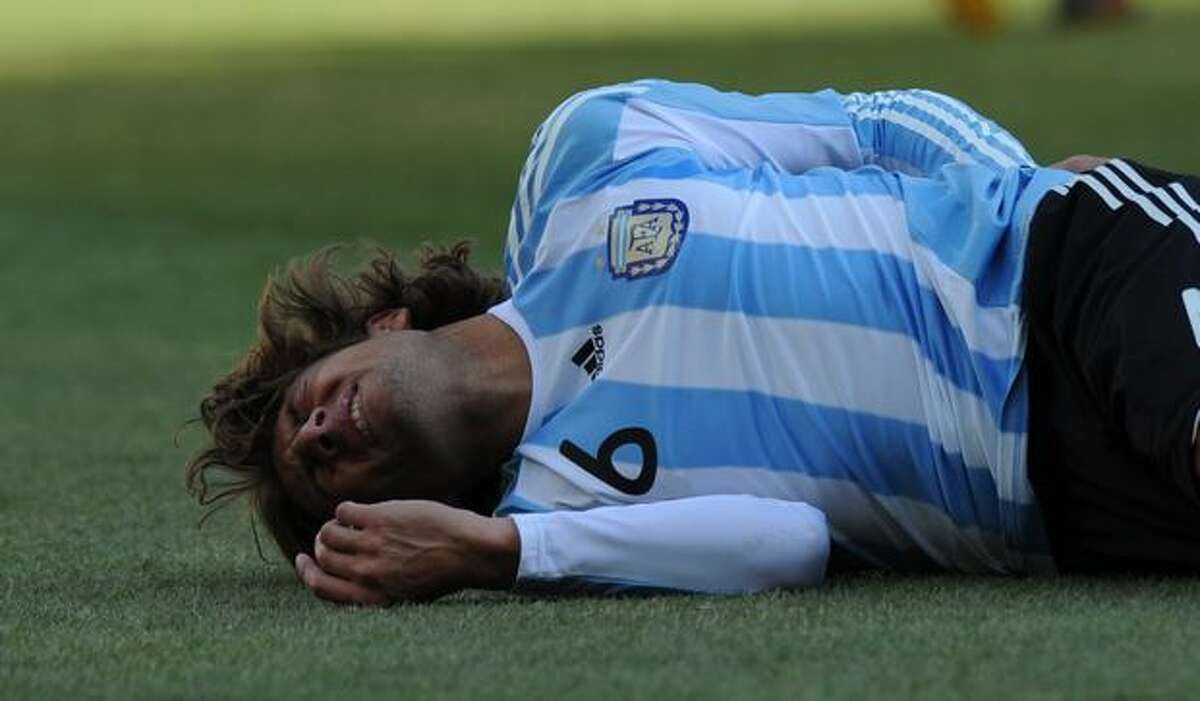 Argentina's defender Gabriel Heinze lies on the ground during their Group B first round 2010 World Cup football match on June 17, 2010 at Soccer City stadium in Soweto, suburban Johannesburg.