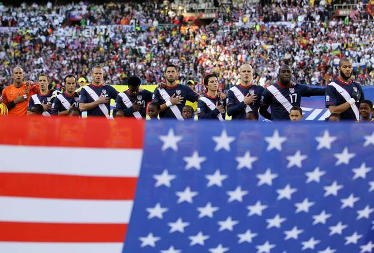 The United States team line up and sing their national anthem ahead of the 2010 FIFA World Cup South Africa Group C match between Slovenia and USA at Ellis Park Stadium on June 18, 2010 in Johannesburg, South Africa.