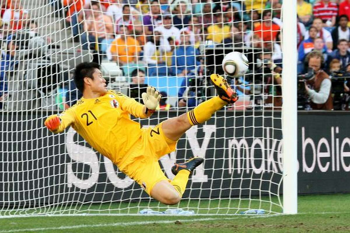 Eiji Kawashima of Japan looks on as a shot from Wesley Sneijder of the Netherlands hits the back of the net during the 2010 FIFA World Cup South Africa Group E match between Netherlands and Japan at Durban Stadium on June 19, 2010 in Durban, South Africa.