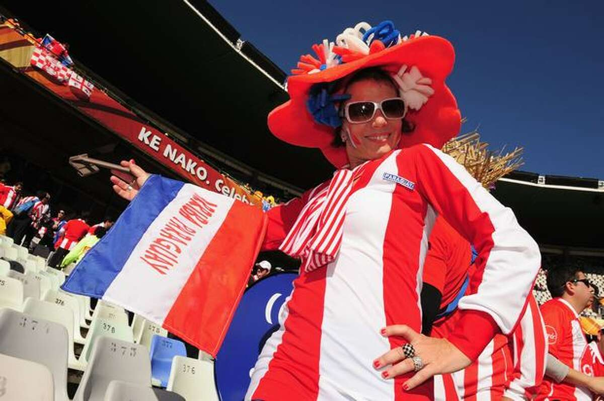 A Paraguay fan enjoys the atmosphere prior to the 2010 FIFA World Cup South Africa Group F match between Slovakia and Paraguay at the Free State Stadium on June 20, 2010 in Mangaung/Bloemfontein, South Africa.