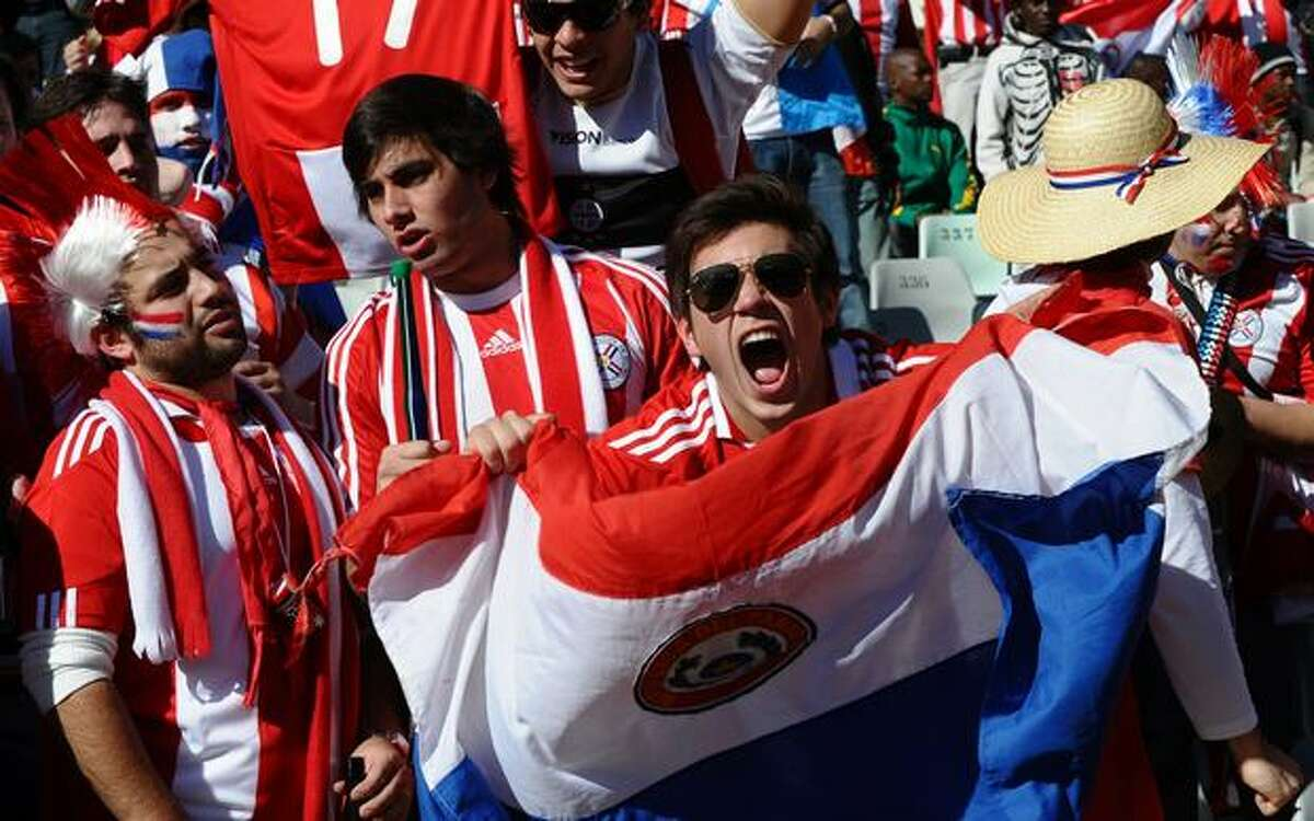 Paraguay fans cheer before the Group F first round 2010 World Cup football match Slovakia versus Paraguay on June 20, 2010 at Free State Stadium in Mangaung/Bloemfontein.