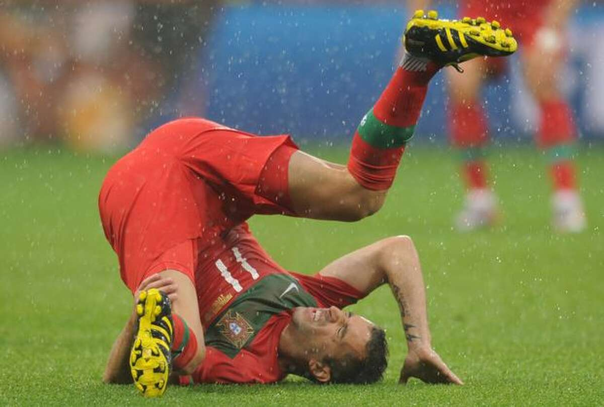 Portugal's striker Cristiano Ronaldo falls during the Group G first round 2010 World Cup football match North Korea versus Portugal on Monday at Green Point stadium in Cape Town.