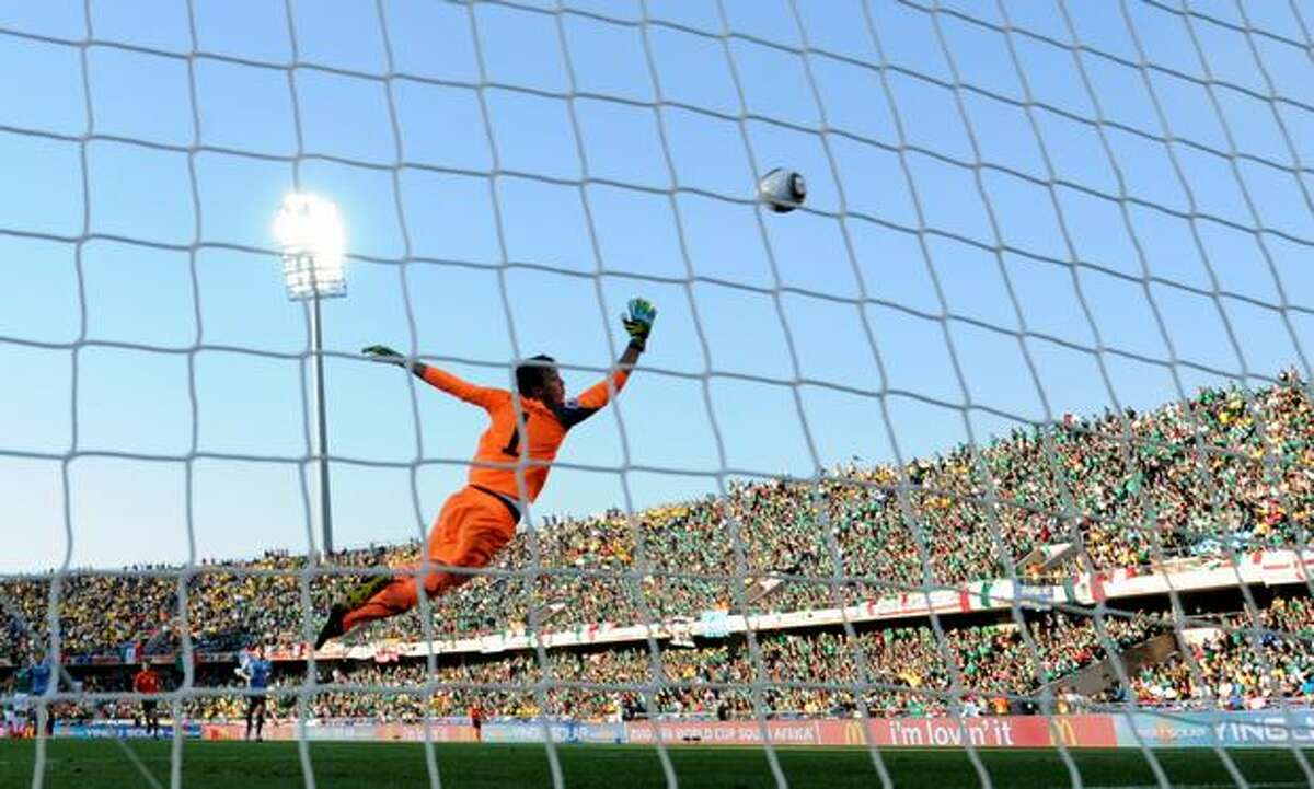 Uruguay's goalkeeper Fernando Muslera leaps for the ball which flies wide of the goal during their Group A first round 2010 World Cup football match on June 22, 2010 at Royal Bafokeng stadium in Rustenburg.