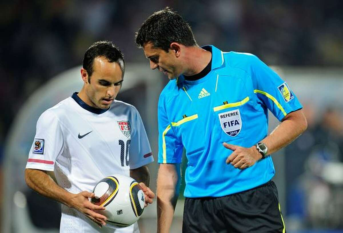 Landon Donovan of the United States speaks to Referee Viktor Kassai with the Jabulani match ball during the 2010 FIFA World Cup South Africa Round of Sixteen match between USA and Ghana at Royal Bafokeng Stadium on June 26, 2010 in Rustenburg, South Africa.