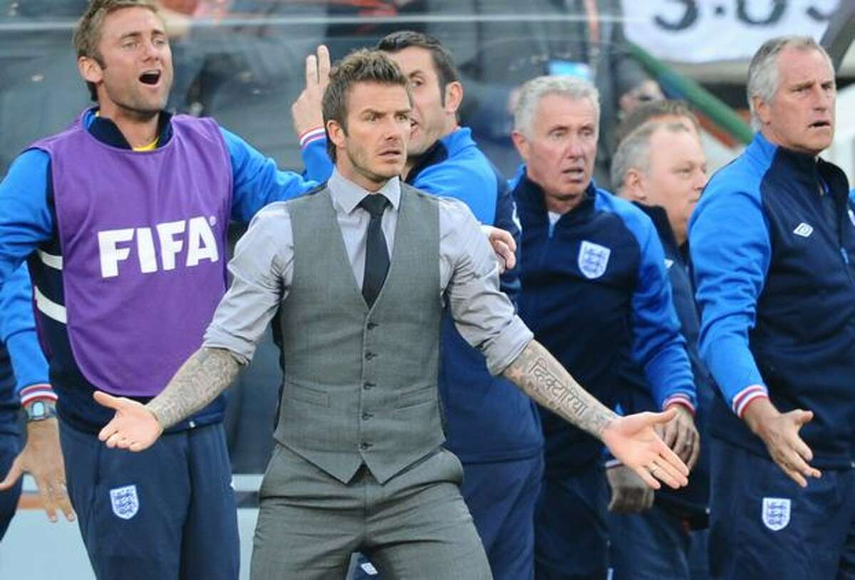 England's injured midfielder David Beckham (2ndL) reacts after a missed goal by England's midfielder Steven Gerrard during the 2010 World Cup round of 16 match Germany vs England on June 27, 2010 at Free State stadium in Mangaung/Bloemfontein. FRANCOIS-XAVIER MARIT