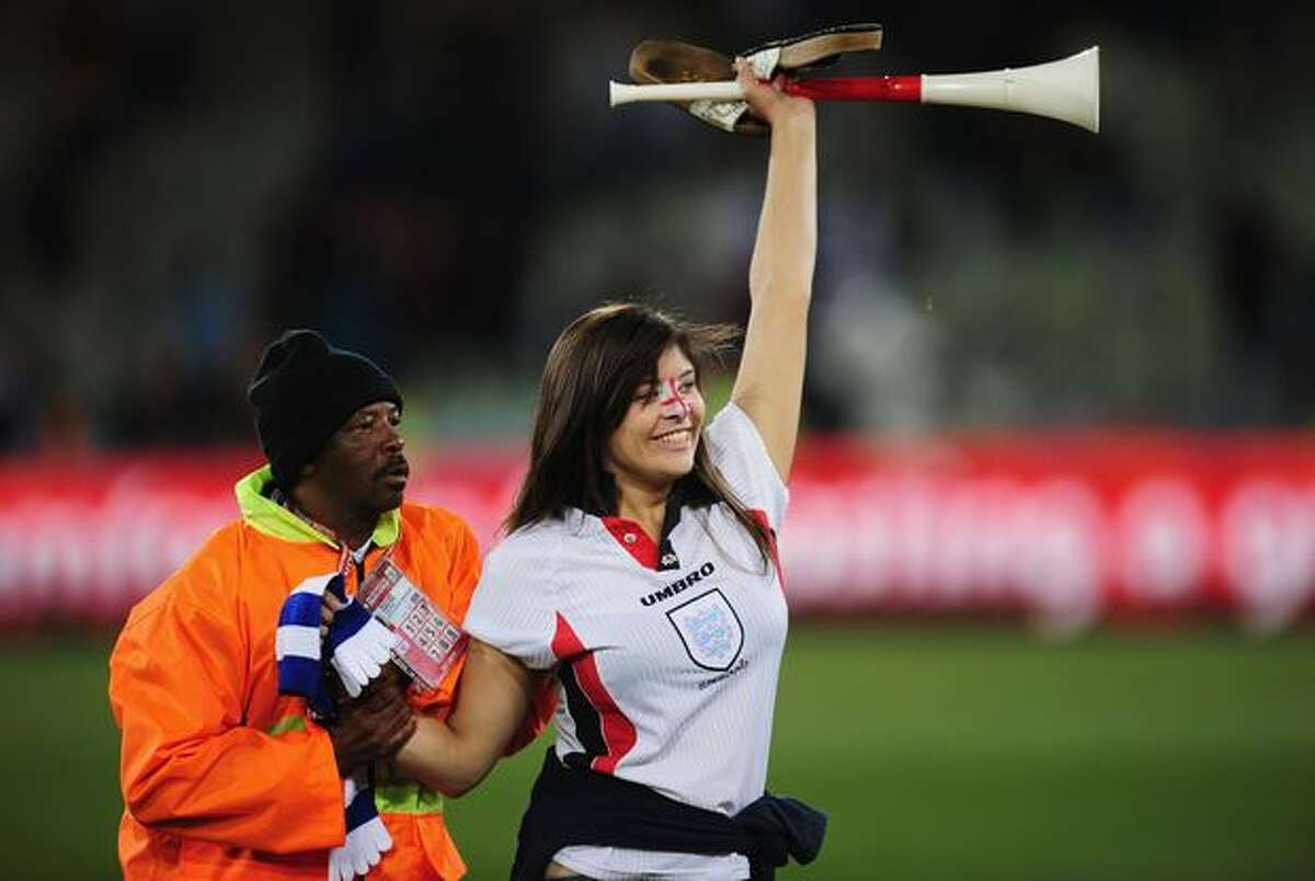 An England supporter runs on to the pitch at the end of play following the 2010 FIFA World Cup South Africa Round of Sixteen match between Germany and England at Free State Stadium on June 27, 2010 in Bloemfontein, South Africa.