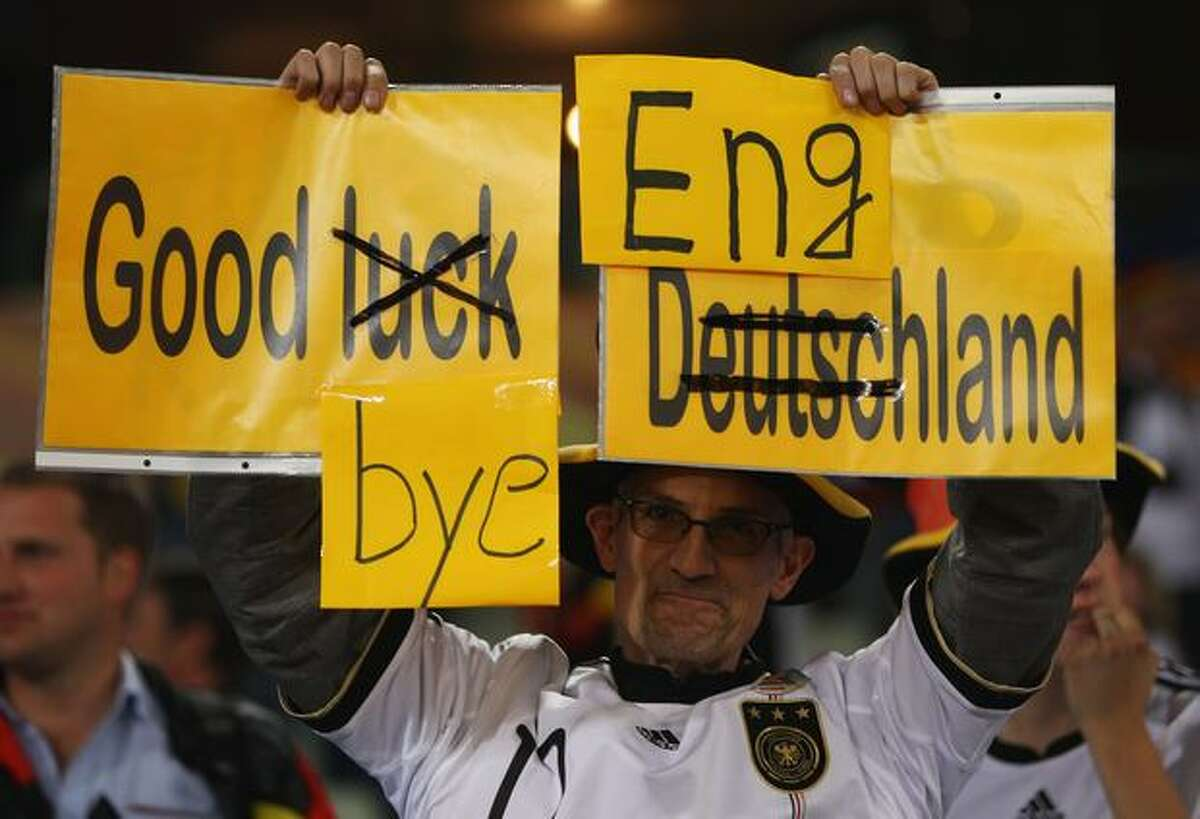 A Germany fan holds up a banner that reads 'Goodbye England' following the 2010 FIFA World Cup South Africa Round of Sixteen match between Germany and England at Free State Stadium on June 27, 2010 in Bloemfontein, South Africa.