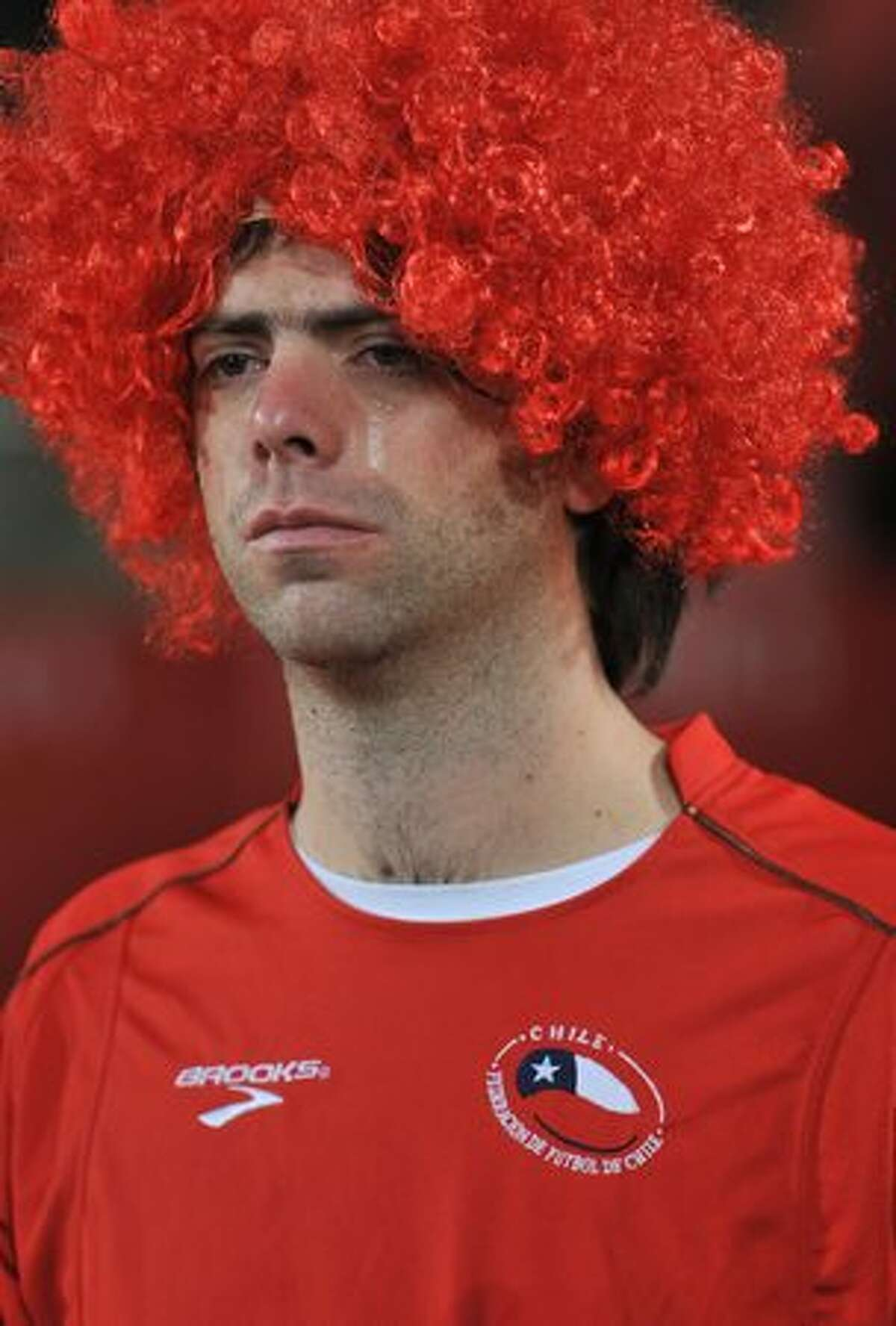 A Chile fan sheds a tear after the 2010 World Cup round of 16 football match Brazil versus Chile at Ellis Park Stadium in Johannesburg. Brazil won the match 3-0.