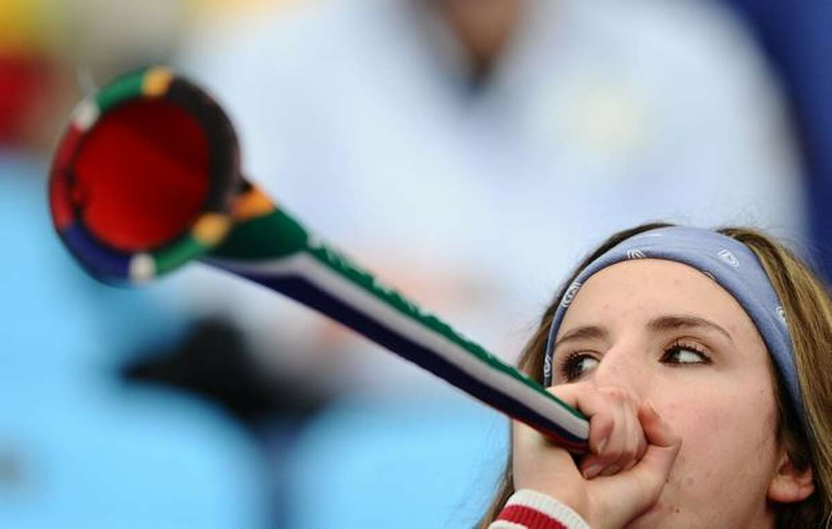 A football fans plays a vuvuzela before the start of the 2010 World Cup round of 16 match Paraguay versus Japan on June 29, 2010 at Loftus Versfeld Stadium in Tshwane/Pretoria.