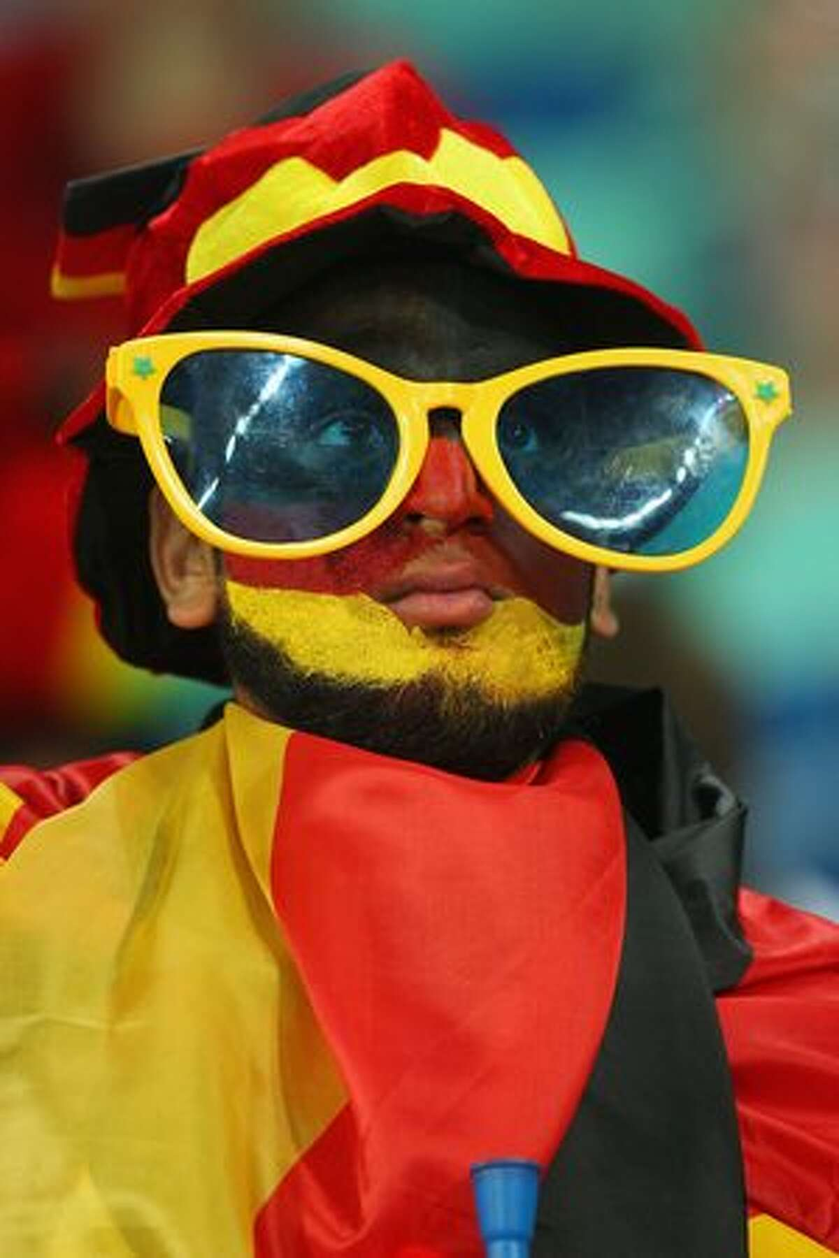 A Germany fan enjoys the atmosphere prior to the 2010 FIFA World Cup South Africa Semi Final match between Germany and Spain at Durban Stadium on July 7, 2010 in Durban, South Africa.