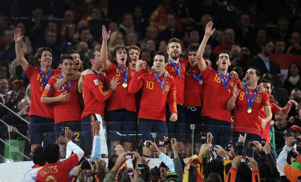 The Spain team celebrate victory on the podium following the 2010 World Cupfinal match between the Netherlands and Spain at Soccer City Stadium in Johannesburg, South Africa on July 11, 2010.