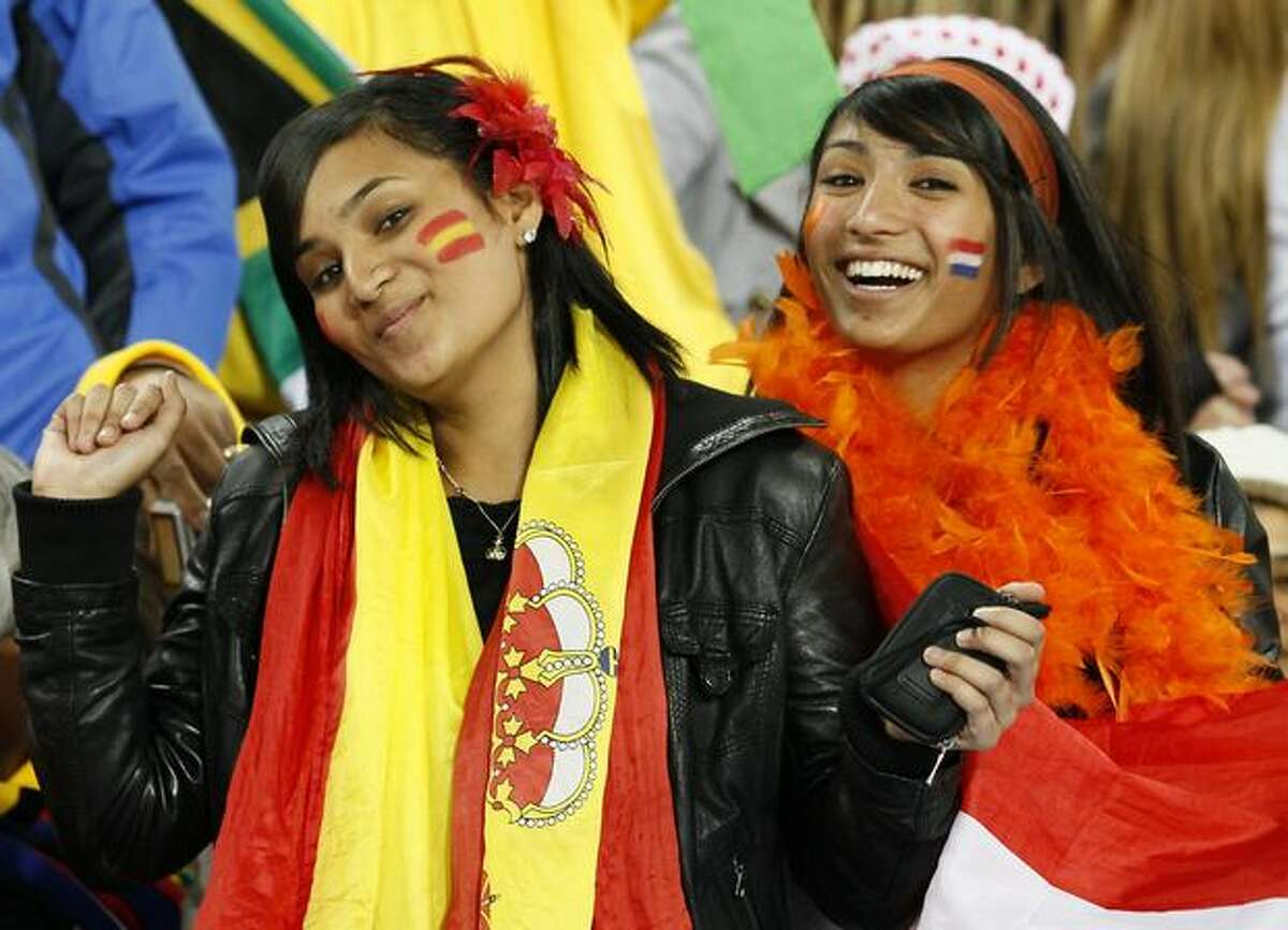 Spain supporters smile prior to the start of the match.