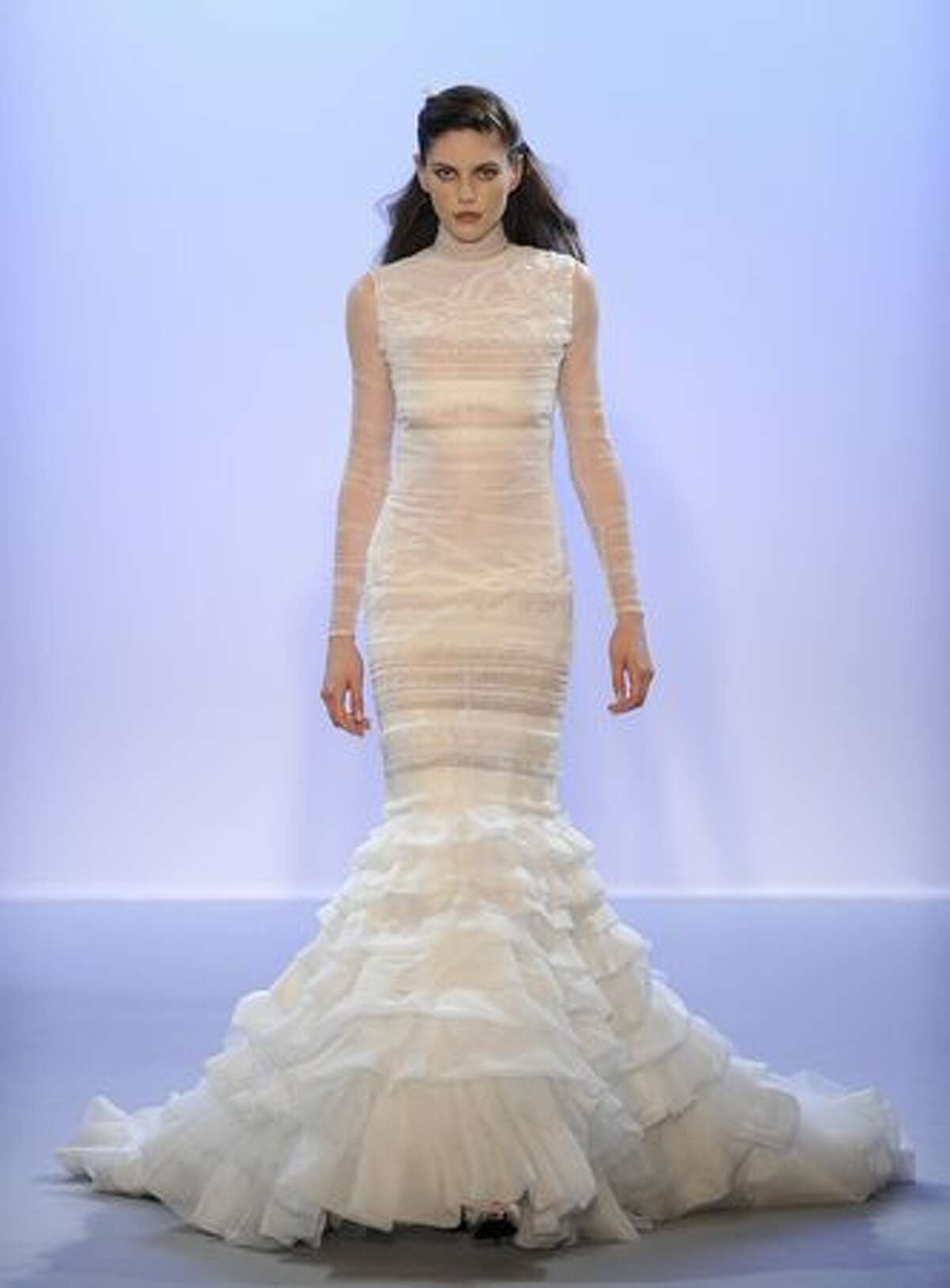 A model presents a creation by Christophe Josse.