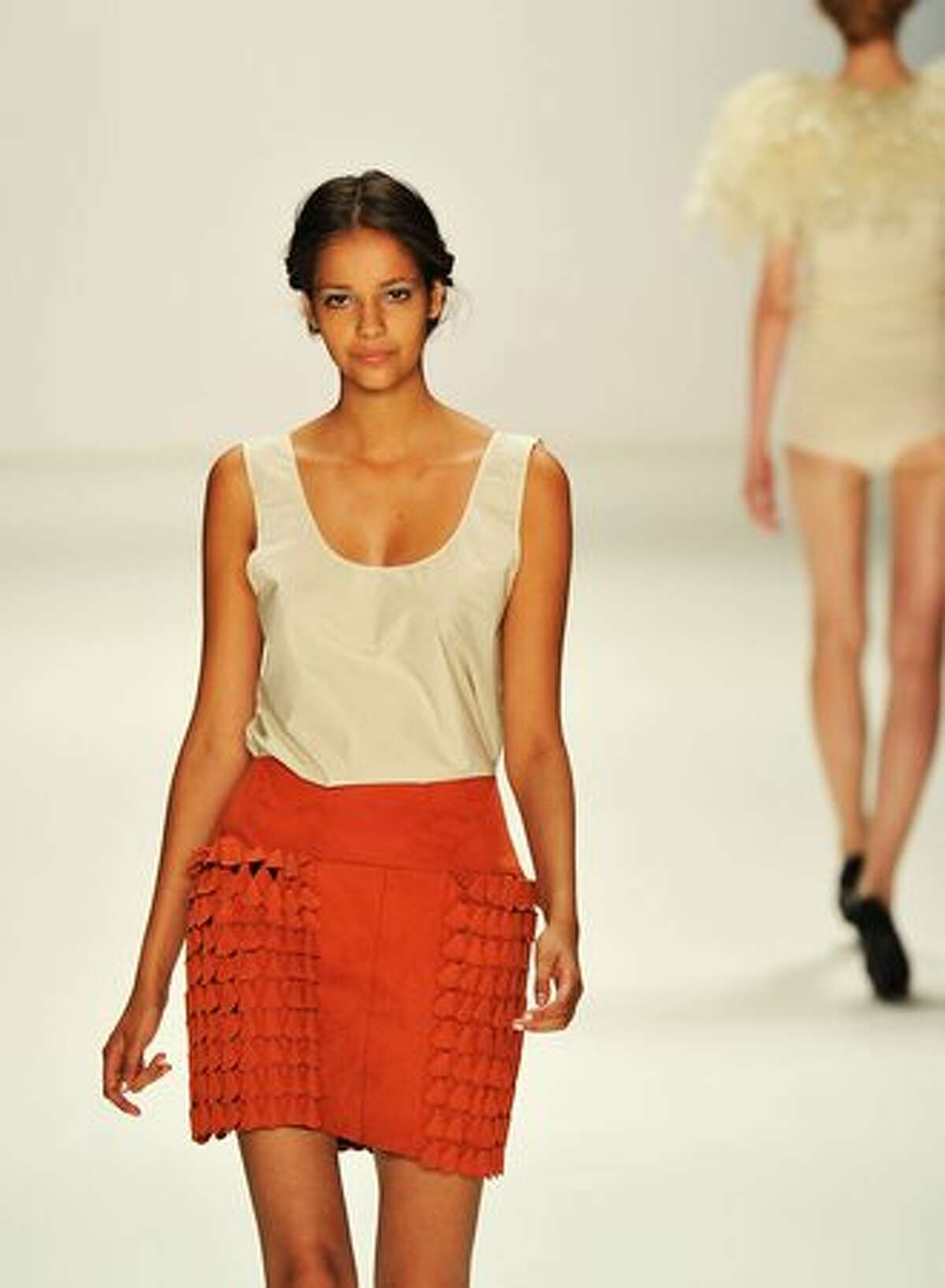 A model walks the runway at the 30Paarhaende Show during the Mercedes Benz Fashion Week Spring/Summer 2011 at Bebelplatz on July 10, 2010 in Berlin, Germany.
