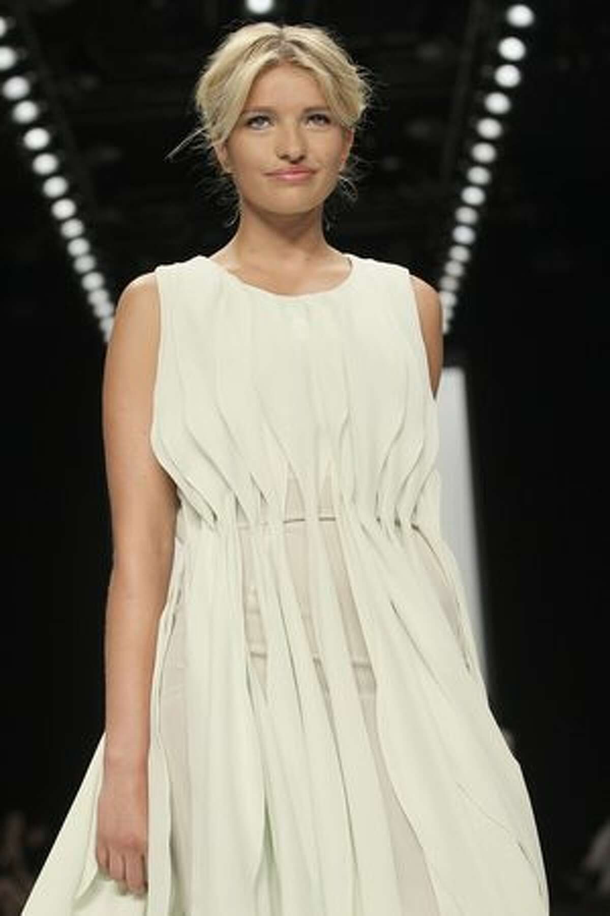 Sarina Nowak walks the runway at the 30Paarhaende Show during the Mercedes Benz Fashion Week Spring/Summer 2011 at Bebelplatz on July 10, 2010 in Berlin, Germany.