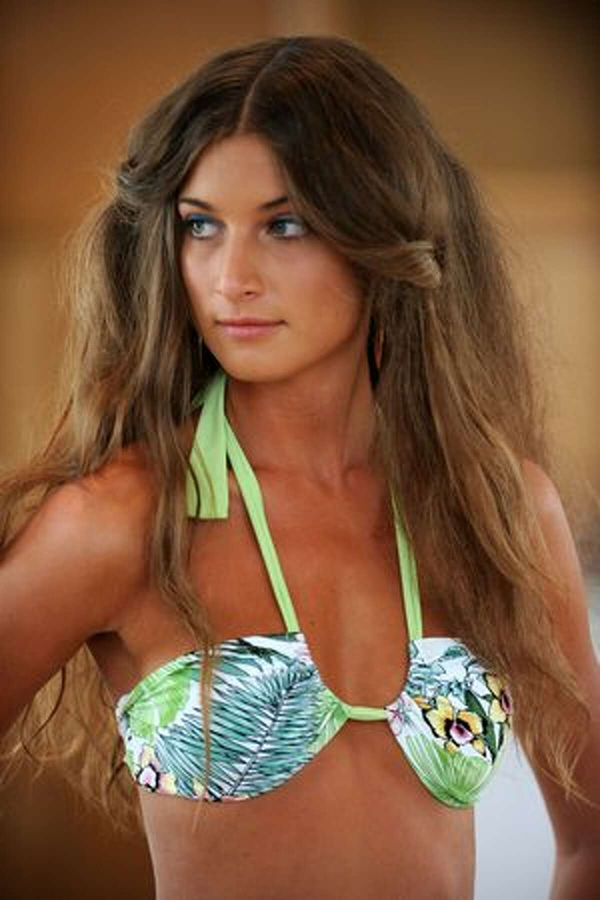A model walks at the White Sands Australia preview during Mercedes-Benz Fashion Week Swim 2011 at The Raleigh on July 16, 2010 in Miami, Florida.