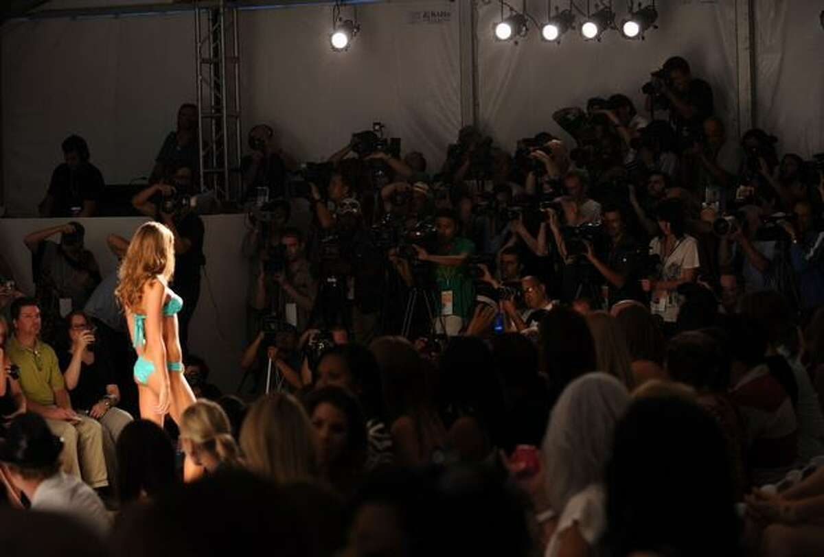 A model walks the runway during the Beach Bunny Swimwear 2011 fashion show during Mercedes-Benz Fashion Week Swim at the Raleigh on July 16, 2010 in Miami Beach, Florida.