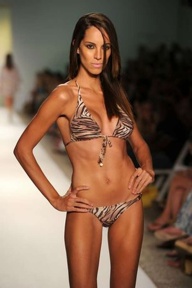 A model walks the runway at the Cia Maritima Swimwear 2011 fashion show during Mercedes-Benz Fashion Week Swim at the Raleigh in Miami Beach, Fla., on Sunday, July 18, 2010. Photo: Getty Images / Getty Images