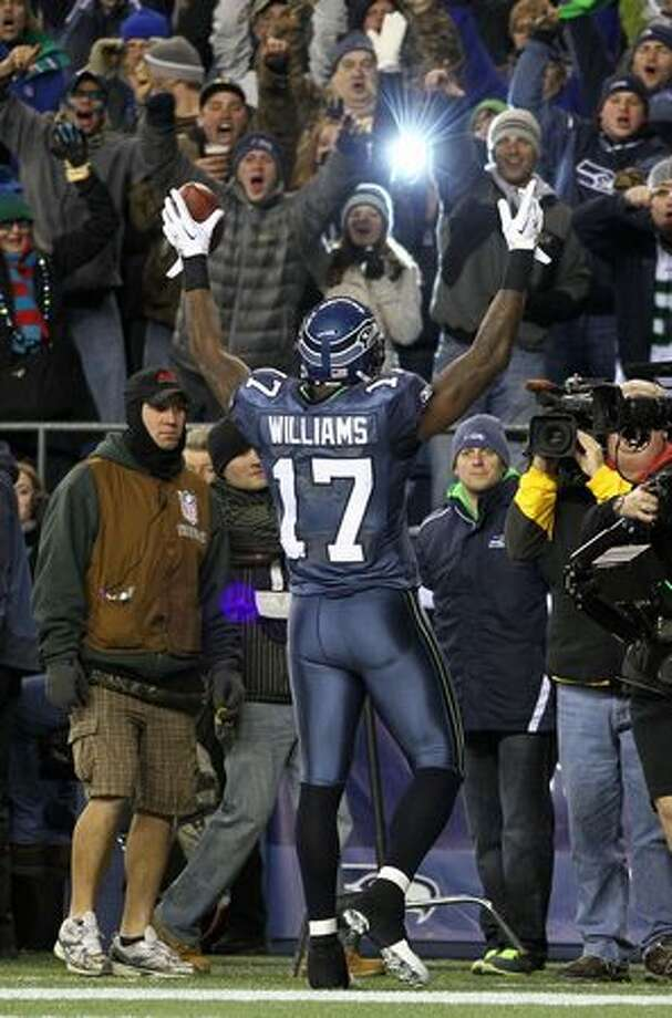 Wide receiver Mike Williams #17 of the Seattle Seahawks celebrates scoring a touchdown in the first quarter against the St. Louis Rams. Photo: Getty Images / Getty Images