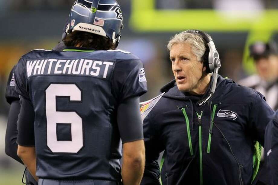 Head coach Pete Carroll of the Seattle Seahawks talks with quarterback Charlie Whitehurst #6 during their game against the St. Louis Rams. Photo: Getty Images / Getty Images