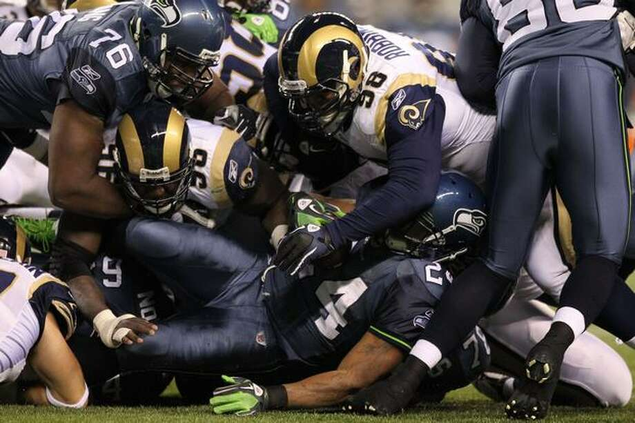 Running back Marshawn Lynch #24 of the Seattle Seahawks is tackled by the St. Louis Rams. Photo: Getty Images / Getty Images