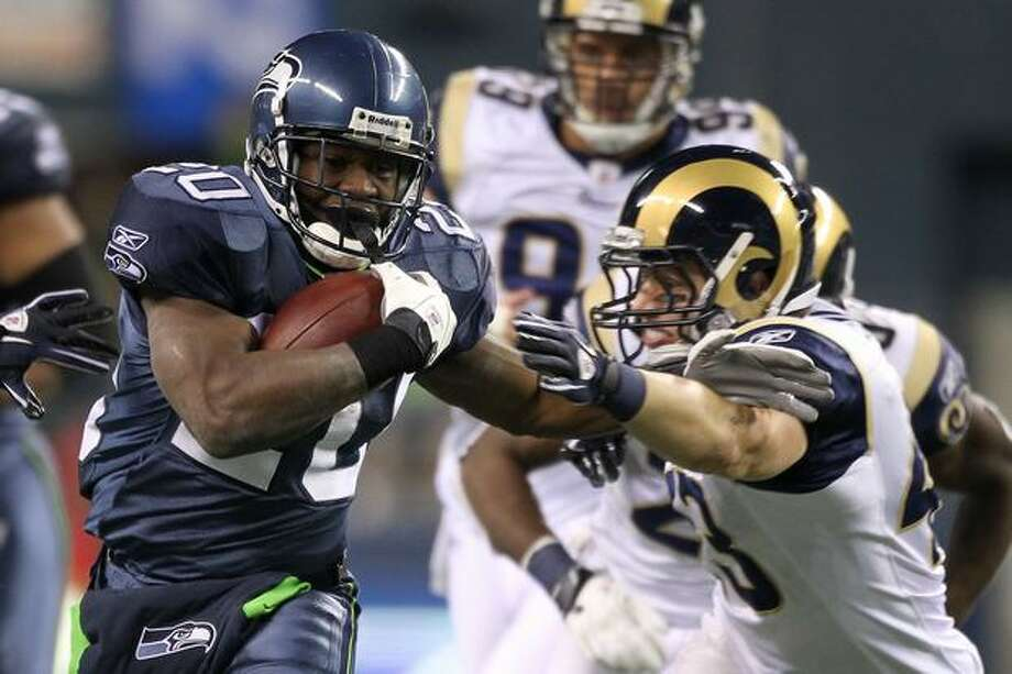 Running back Justin Forsett #20 of the Seattle Seahawks rushes with the ball against the St. Louis Rams. Photo: Getty Images / Getty Images