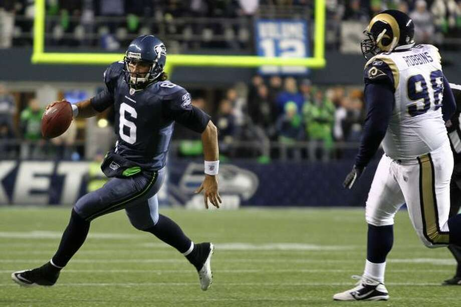 Quarterback Charlie Whitehurst #6 of the Seattle Seahawks runs with the ball during their game against the St. Louis Rams. Photo: Getty Images / Getty Images
