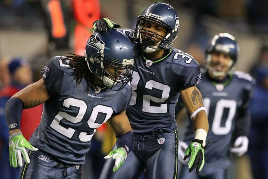 Safety Earl Thomas #29 and cornerback Marcus Brown #32 of the Seattle Seahawks celebrate a defensive play against the St. Louis Rams. Photo: Getty Images / Getty Images