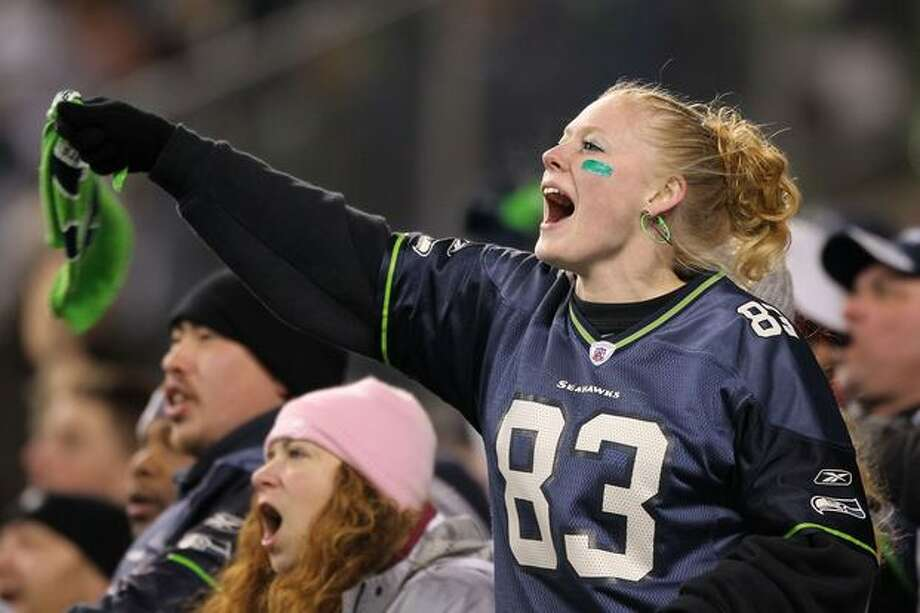A fan of the Seattle Seahawks cheers during their game against the St. Louis Rams. Photo: Getty Images / Getty Images