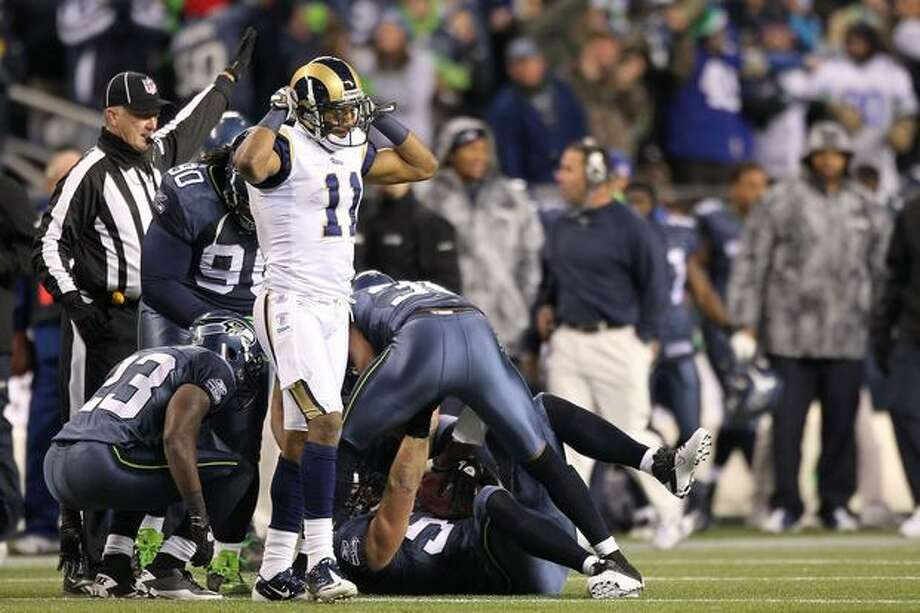 Wide receiver Brandon Gibson #11 of the St. Louis Rams reacts after the ball was intercepted by Will Herring #54 of the Seattle Seahawks in the fourth quarter. Photo: Getty Images / Getty Images