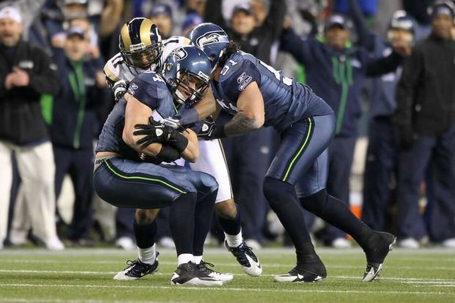 Linebacker Will Herring #54 of the Seattle Seahawks interceps a pass by quarterback Sam Bradford #8 of the St. Louis Rams during the fourth quarter. Photo: Getty Images / Getty Images