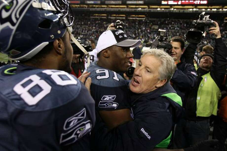Head coach Pete Carroll of the Seattle Seahawks hugs defensive end Chris Clemons #91 after defeating the St. Louis Rams 16-6. Photo: Getty Images / Getty Images