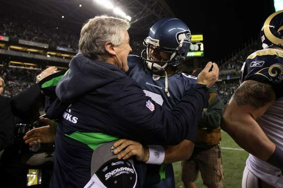 Head coach Pete Carroll of the Seattle Seahawks hugs quarterback Charlie Whitehurst #6 after defeating the St. Louis Rams 16-6. The Seahawks became the first team to advance to the playoffs with a losing record. Photo: Getty Images / Getty Images