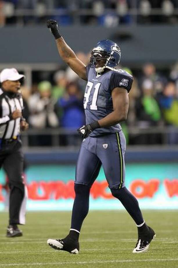 Defensive end Chris Clemons #91 of the Seattle Seahawks celebrates advancing to the playoffs after defeating the St. Louis Rams 16-6. Photo: Getty Images / Getty Images