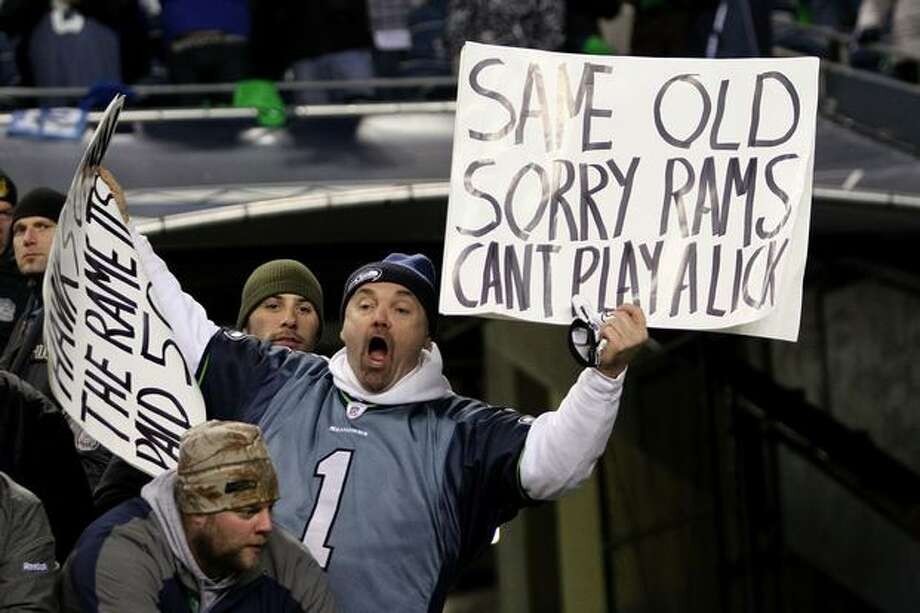 A fan of the Seattle Seahawks holds a sign. Photo: Getty Images / Getty Images