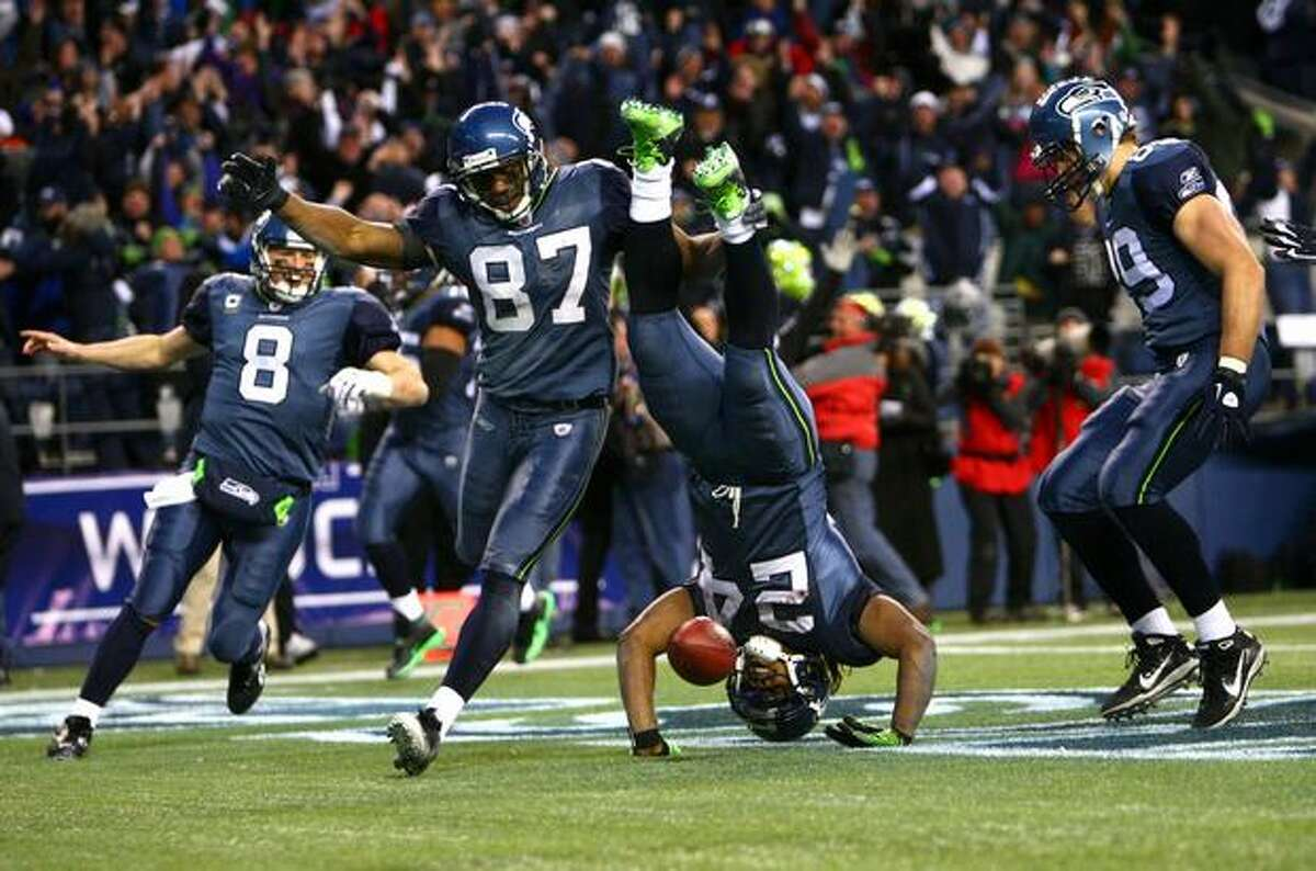 Seahawks running back Marshawn Lynch flips into the end zone at the end of the epic