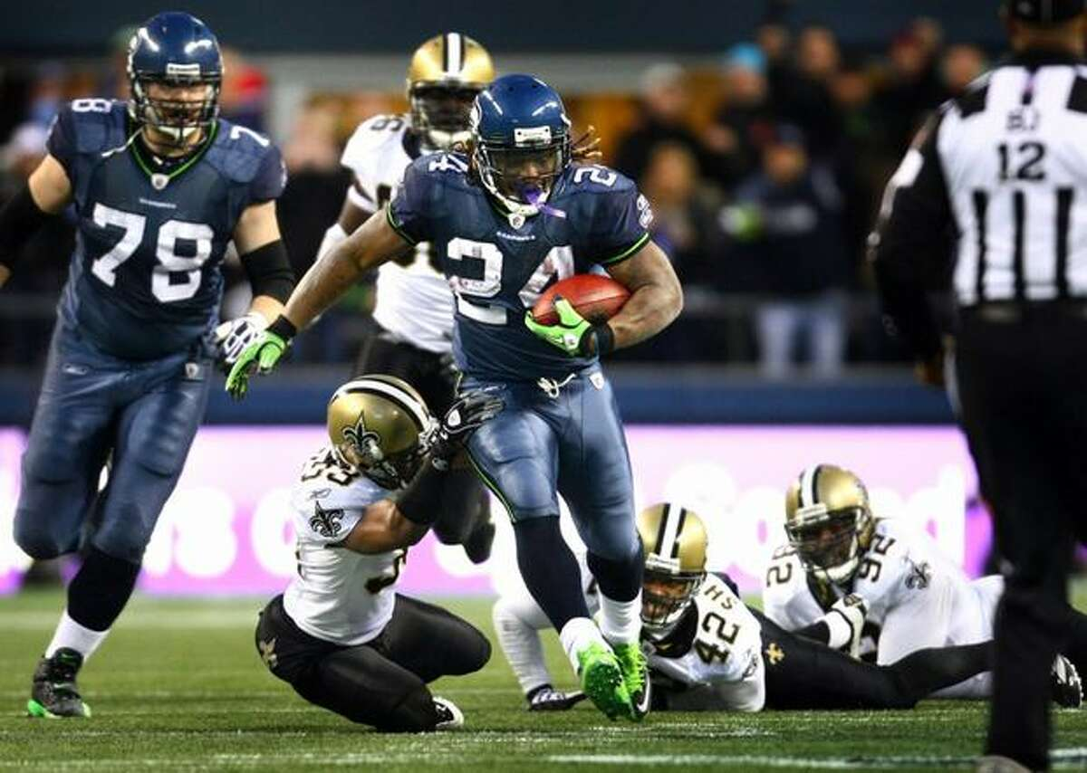Seahawks running back Marshawn Lynch breaks through New Orleans defenders during the epic