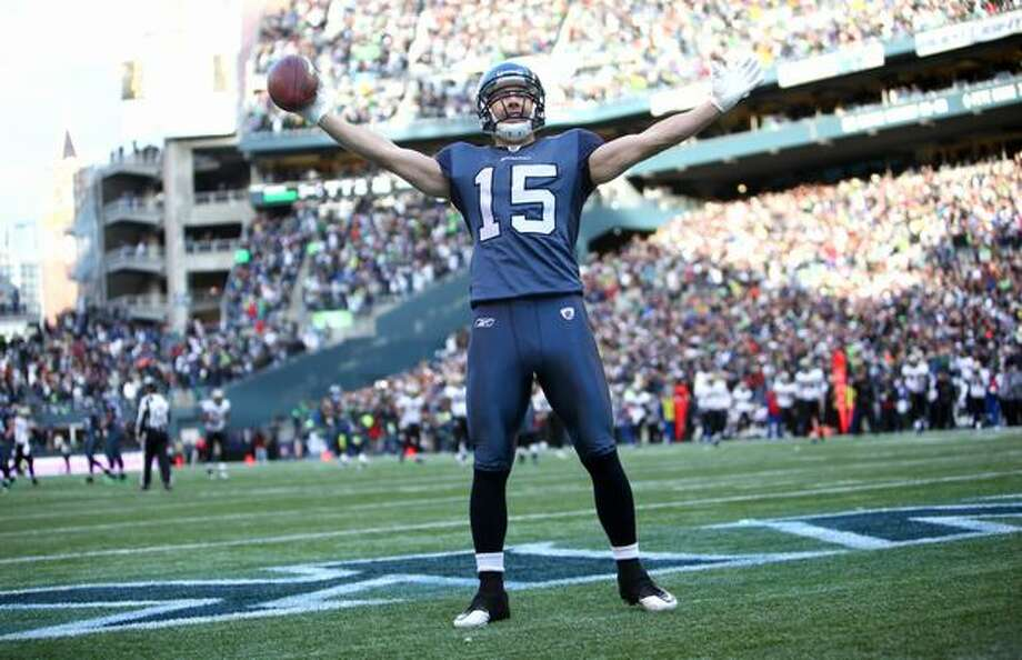 Brandon Stokley raises his arms as he enters the end zone for a Seahawks touchdown against the defending Super Bowl champion New Orleans Saints in the second quarter of an NFL wild-card playoff game at Qwest Field in  Seattle on Saturday, Jan. 8, 2010. The Hawks defeated the Saints 41-36. Photo: Joshua Trujillo, Seattlepi.com / seattlepi.com