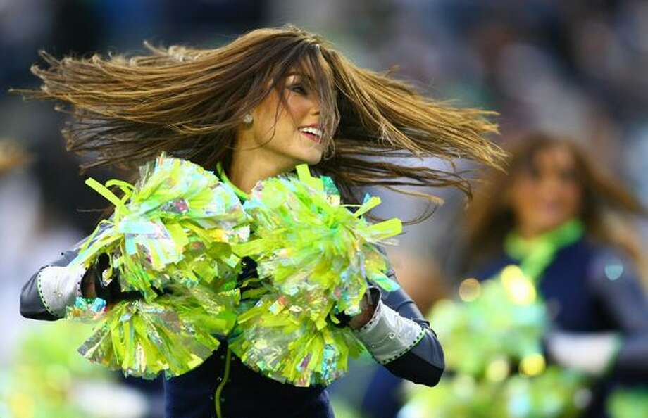 A Seahawks cheerleader spins while performing a routine. Photo: Joshua Trujillo, Seattlepi.com / seattlepi.com
