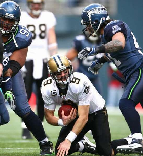 New Orleans quarterback Drew Brees looks up after being sacked by the Seahawks in the first half.