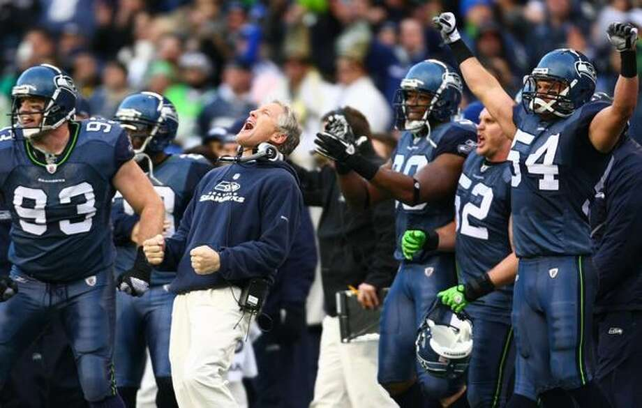Seahawks coach Pete Carroll and the bench erupt after the Hawks stopped the New Orleans Saints on a fourth-down play in the second half. Photo: Joshua Trujillo, Seattlepi.com / seattlepi.com