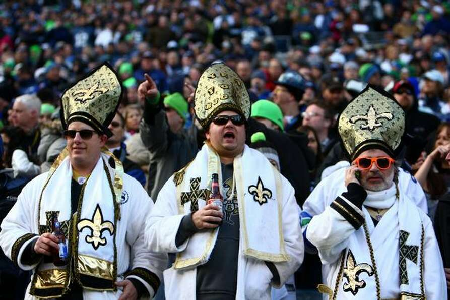 Saints fans watch the action in the first half.