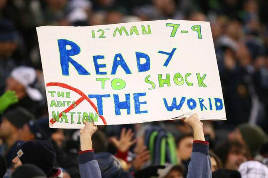 A Seahawks fan holds up a sign during the game.