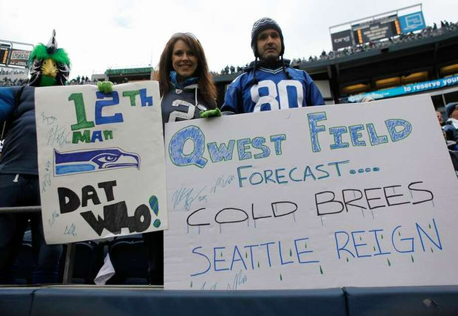 Seattle Seahawks fans hold up a sign before the Seahawks take on the New Orleans Saints during the 2011 NFC wild-card playoff game at Qwest Field on January 8, 2011 in Seattle, Washington. Photo: Getty Images / Getty Images