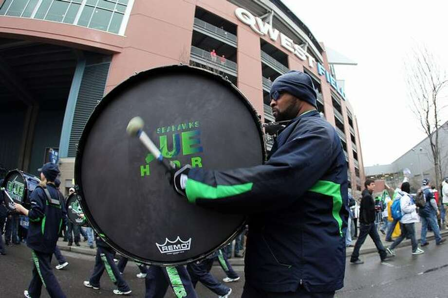 A member of the Seattle Seahawks band performs outside Qwest Field before the Seahawks take on the New Orleans Saints in the 2011 NFC wild-card playoff game on January 8, 2011 in Seattle, Washington. Photo: Getty Images / Getty Images