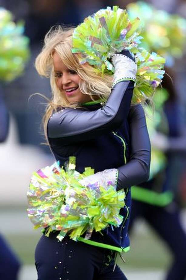 A Seattle Seahawks cheerleader performs before the Seahawks take on the New Orleans Saints in the 2011 NFC wild-card playoff game at Qwest Field on January 8, 2011 in Seattle, Washington. Photo: Getty Images / Getty Images